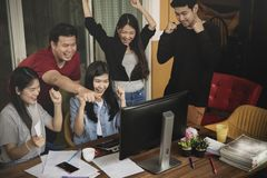 Asian younger freelance teamwork  job successfull happiness emot Stock Photography