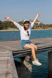 Asian younger woman happiness emotion at sea side traveling dest Royalty Free Stock Image