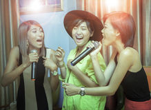 Asian younger woman singing karaoke with relaxing and happiness Royalty Free Stock Photography