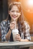 Asian younger woman toothy smiling face happiness drinking cool. Asian younger woman   toothy smiling face happiness drinking cool beverage Royalty Free Stock Image