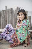 Asian younger woman toothy smiling face relaxing in traveling destination stock photo