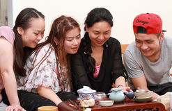 Asian Youth watch mobile phone laugh. The four Asian Youth watch mobile phone laugh Stock Images