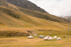 Asian yurts of the nomads on the beautiful mountain meadow in Kyrgyzstan Royalty Free Stock Photography