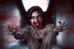 Asian zombie man in the empty room Royalty Free Stock Images