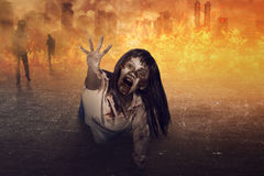 Asian zombie woman is anger. Ugly face and fire background royalty free stock photo