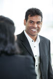 Asianbusiness man talking to coworker. Stock Photography