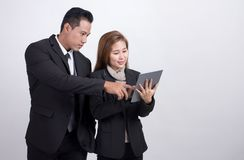 Asians businessman and adviser businesswoman discussing and working together with digital tablet on white background. Portrait of Asians executive businessman stock image