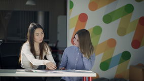 Asians and Europeans at the table to discuss the project on paper. stock footage