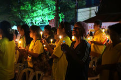 Asians stand with candles. Thais pray for the health of the king. December 2, 2015 - The king`s birthday a national holiday in Thailand. Thais pray for the stock photos