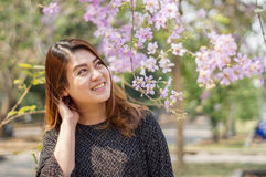 Asians women. Beautiful asians woman among pink flower stock images