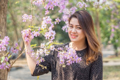 Asians women. Beautiful asians woman among pink flower, soft focus stock photos