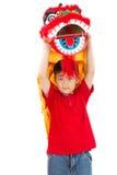 Asiat Little Boy in Chinese-Lion Custome Dance During Chinese-Ne Lizenzfreies Stockbild