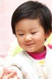 asiatet behandla som ett barn Royaltyfri Bild