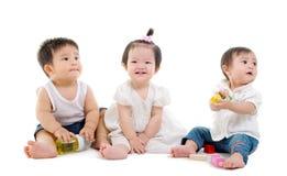 Asiatet behandla som ett barn Arkivfoto