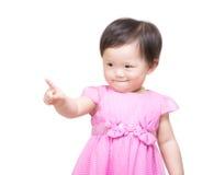 Asiatet behandla som ett barn flickan som pekar till dig Arkivfoto