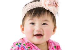 Asiatet behandla som ett barn leende Arkivbild