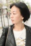 Asiatet mognar kvinnan Arkivfoton
