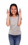 Asiatic charming young woman crossing the fingers Stock Image