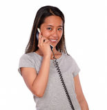 Asiatic charming young woman speaking on phone Royalty Free Stock Photography