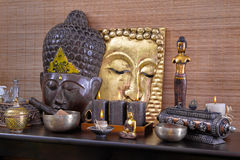 Asiatic decoration in brown and gold with buddha and candles at Stock Photos