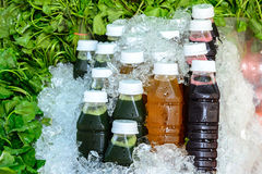 Asiatic juice, Chrysanthemum juice and Roselle juice in bottle on ice with asiatic leaf Royalty Free Stock Photography