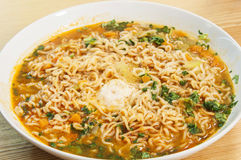 Asiatic noodles soup. A plate with a delicious and spicy asiatic noodles soup Stock Photos