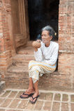 Asiatic old woman smoking Stock Photo
