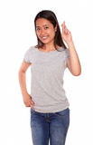 Asiatic smiling young woman crossing the fingers Stock Photos