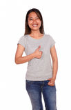 Asiatic smiling young woman showing you ok sign Stock Photography