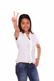 Asiatic woman smiling and showing you victory sign Royalty Free Stock Photos