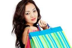 Asiatic women with shopping bags, isolated Royalty Free Stock Images