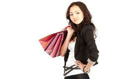 Asiatic women with shopping bags, isolated Stock Photos