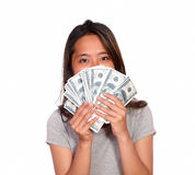 Asiatic young female with cash money Stock Photos