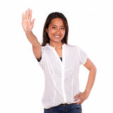 Asiatic young woman smiling and greeting at you Stock Images