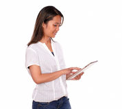 Asiatic young woman working on tablet pc Royalty Free Stock Photography