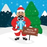 Asiatico sveglio Santa Claus con un regalo in sue mani Paesaggio delle montagne, foresta, neve Progettazione piana moderna Immagine Stock Libera da Diritti