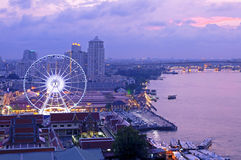 Asiatique against Chao Phraya river at twilight Royalty Free Stock Images