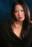 Asiatique sur le fond bleu Photographie stock