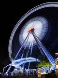 Asiatique in Thailand. Big Ferris Wheel swirling at night in Asiatique The Riverfront. Over 500 fashion boutiques housed in Factory District of Asiatique The Stock Image