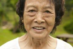 Asiatische ältere Frau Stockfotografie