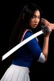 Asiatische Dame mit Klinge im Studio Lizenzfreie Stockbilder