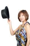 Asiatische Frau, die einen Spitzenhut trägt Stockbilder