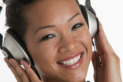Asiatische Frau mit Kopfhörern Stockbilder