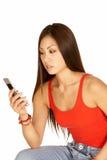 Asiatische Frauen-wählendes Kamera-Telefon Stockfotos