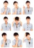 Asiatische Gesichtsausdruckzusammensetzung des jungen Mannes lokalisiert auf Weiß Lizenzfreies Stockfoto