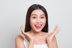 Asiatische Mädchenhandnotenbacke und -lächeln attraktiv Haut healthcar Lizenzfreies Stockfoto