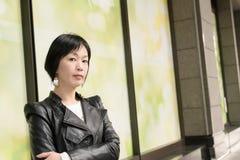 Asiatische reife Frau stockbilder