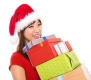 Asiatische Weihnachtsfrauen-Holdinggeschenke Stockfoto