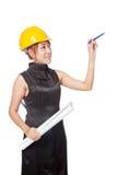 Asiatischer Architektenmädchen-Griffplan und zeigen einen Stift oben Stockfotos