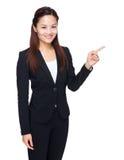 Asiatischer Geschäftsfrau-Fingerpunkt beiseite Stockfotos